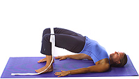 Yoga: Spinal lift half bridge with strap